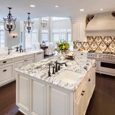Luxurious All White Kitchen With Graphic Backsplash