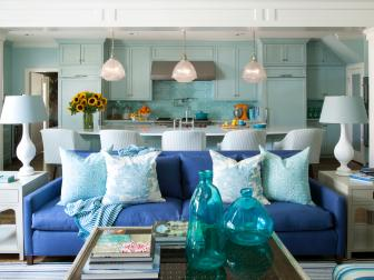 Transitional Open Plan Kitchen and Living Area With Blue Sofa