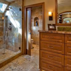 craftsman master bathroom with neutral tile floors