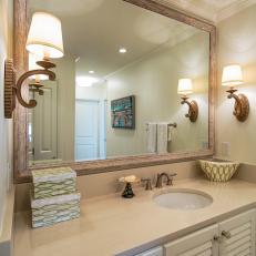 Coastal Master Bathroom With Wood Framed Mirror