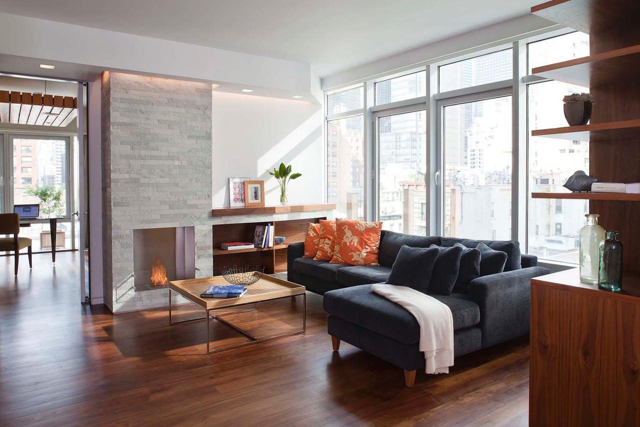 Two apartments combined into a modern urban space eisner Modern living room with fireplace