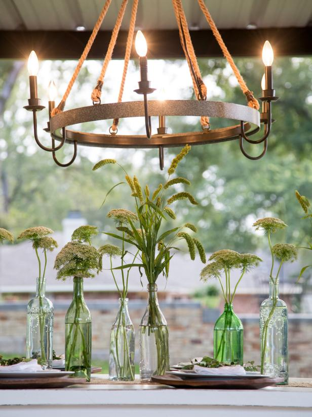 The outdoor dining area gets a rope and metal chandelier to light up the space.