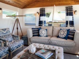 Blue and White Coastal Living Room With Sailboat
