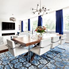 Contemporary Dining Room With Blue Rug