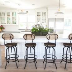 Cottage-Style Kitchen With Vintage-Inspired Bar Stools