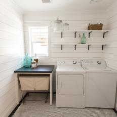 White, Cottage-Style Laundry Room With Penny Tile Floor