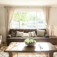 Cozy Living Room With Gray Sofa, Large Picture Window