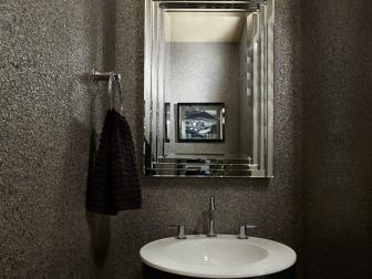 Sparkling Contemporary Bathroom With Glittering Walls, Circular Vanity and Black Shaded Sconce