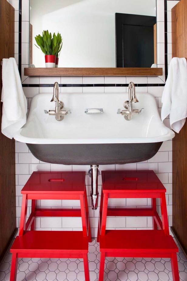 Kids' Bathroom With Bold Red Accessories
