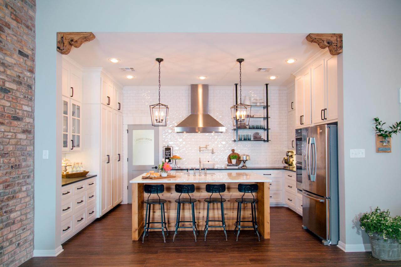 Fixer upper kitchen pendants - Kitchen With Large Center Island And Industrial Pendant Lights