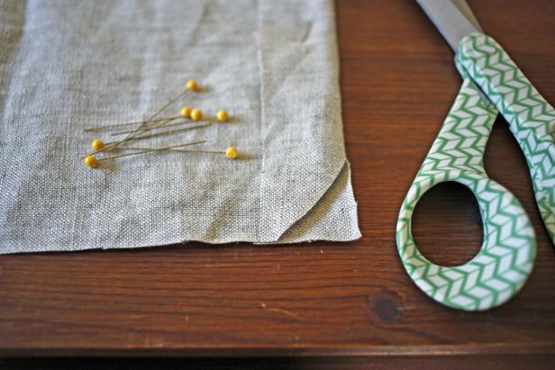 Cut the edge of the fabric piece to create a smooth corner.