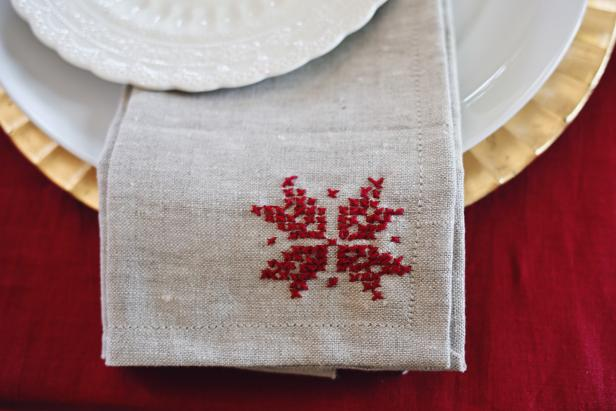 Add some modern folk to your holiday table with cross-stitched poinsettia napkins.