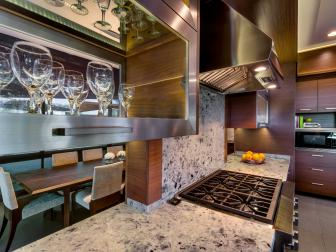 Contemporary Kitchen With Steel Accents and Ice Age Granite Countertops