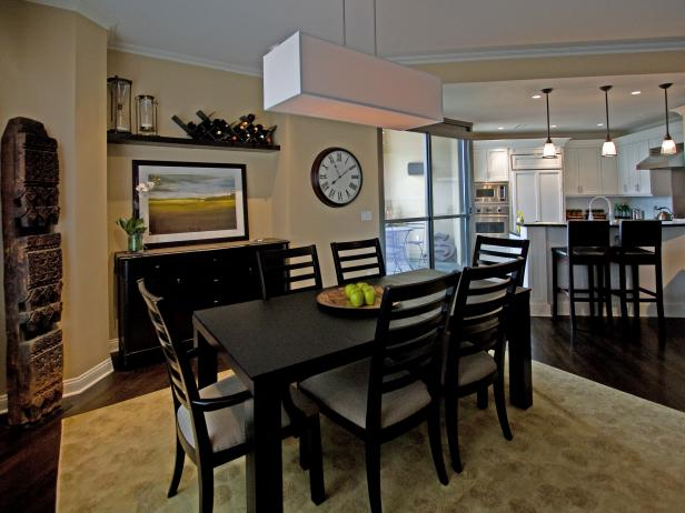 Open Dining Area With Rectangular Pendant Light and Dark Table