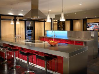Contemporary Open Kitchen Features Bright Red Cabinets