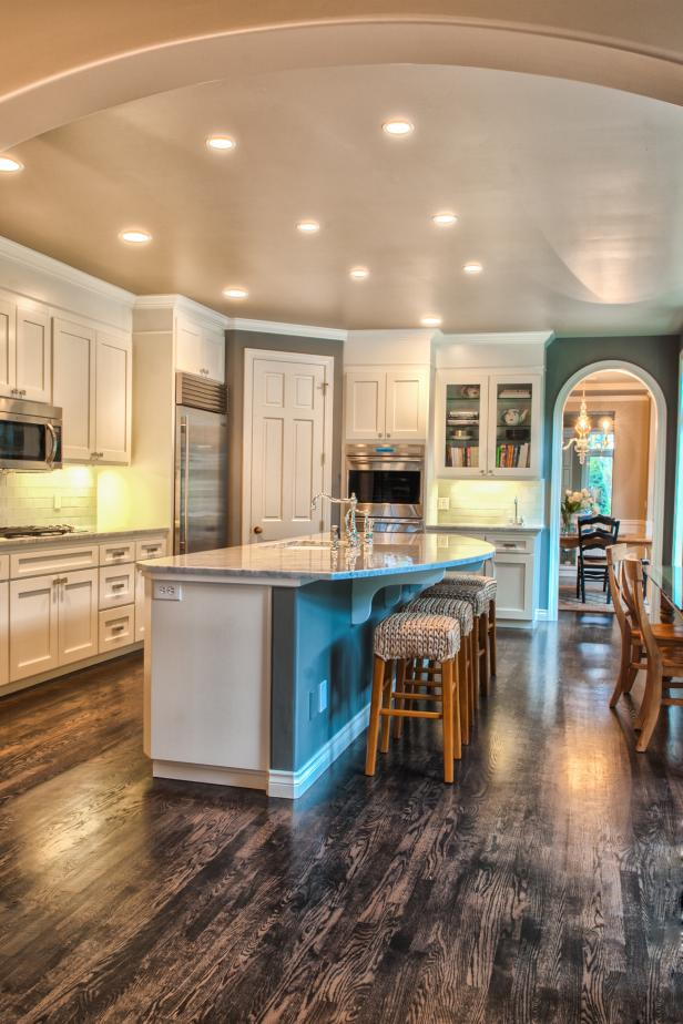 Transitional Gray Kitchen With White Cabinets and Wood Floors