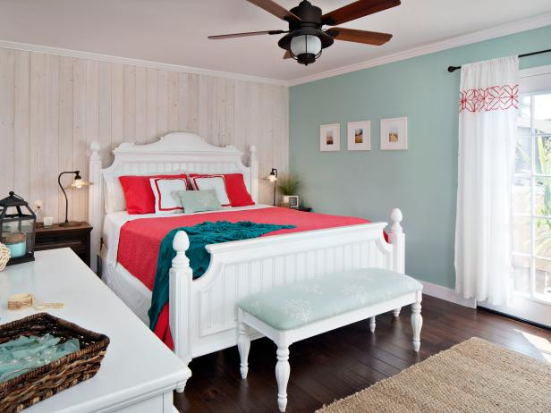 Bright Cottage Bedroom With Coastal Vibes Features Natural Wood Accent Wall, Light Turquoise Details and Pops of Salmon