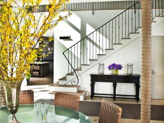 A Round Glass Table Takes Center Stage In A Downstairs Dining Room