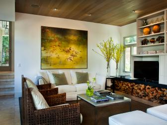 A Floral Painting and Firewood Complement A Villa Home's Gardens Through Interior Design
