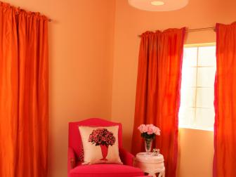 Bright Transitional Sitting Area Features Hot Pink Chair & Ottoman