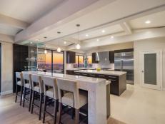White Modern Open Plan Kitchen With Eating Bar