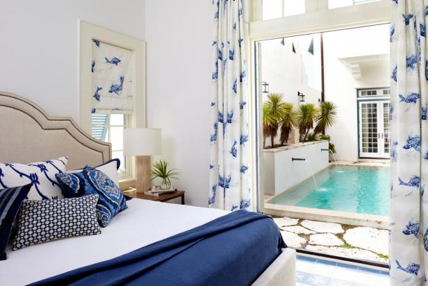 Blue and White Transitional Bedroom With Fish Print Curtains
