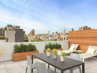 Contemporary Rooftop Patio With Ipe Wood Wall & Planters
