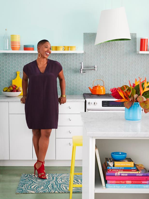 Women Standing in Her Colorful Kitchen