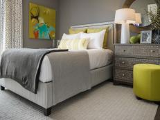 A private guest room on the first floor offers cool gray hues with cheerful pops of yellow and is easily accessible for any overnight guest.