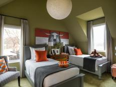 This kid-friendly bedroom is packed with playful colors, geometric patterns and Texas touches.