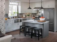 Defined by modern white cabinetry and a complementary gray island, this clever kitchen is packed with high-tech surprises.