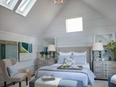 Neutral Master Bedroom With Sloped Ceiling