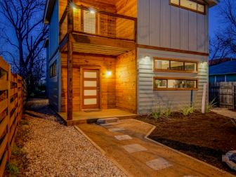 Contemporary Home Exterior With Stone Ground Cover