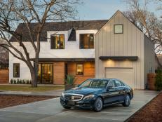 An integrated, one-car garage incorporates sleek design elements from the modern Austin farmhouse.