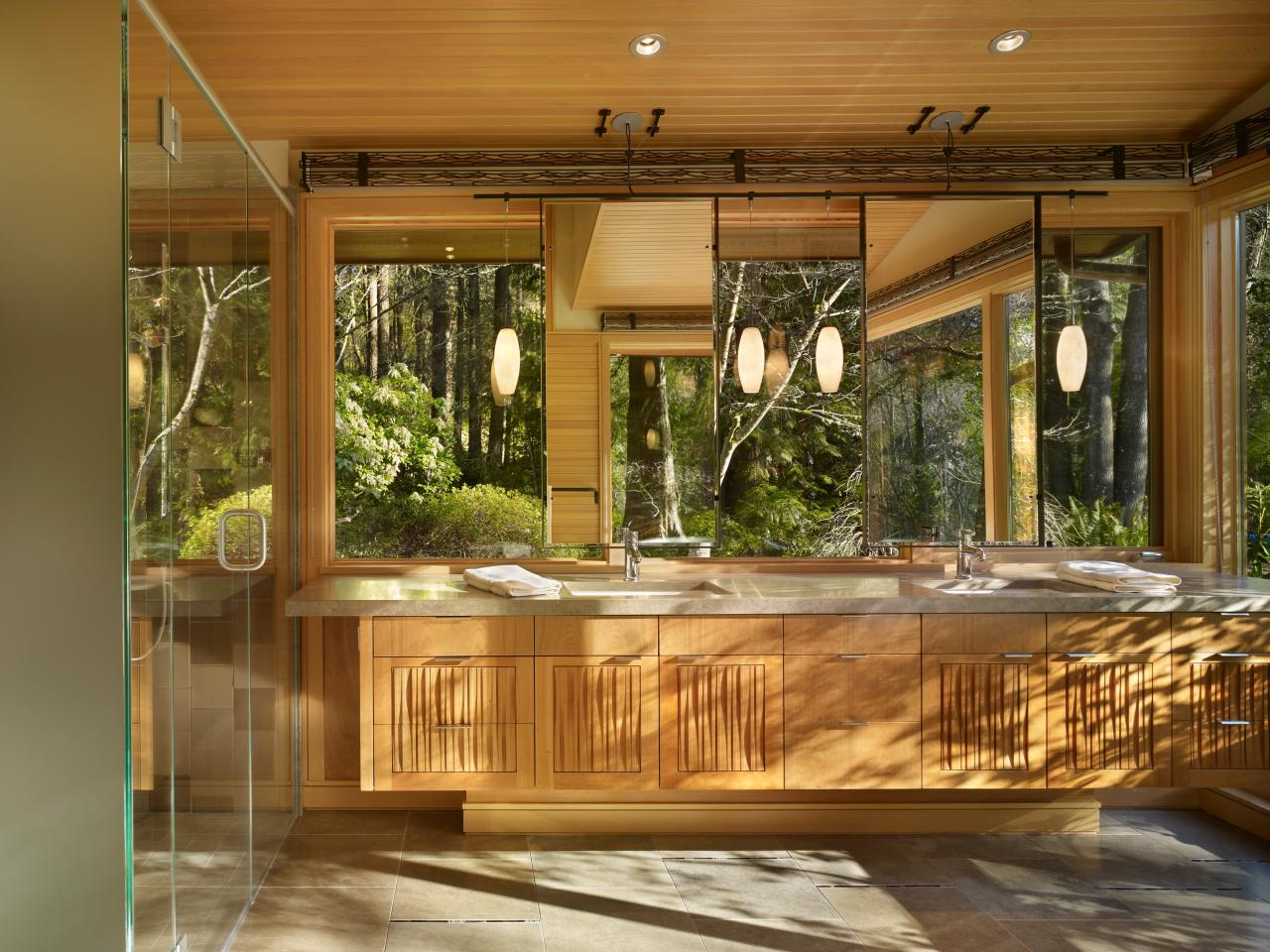 Contemporary double vanity bathroom with forest view this serene bathroom features a large - Tropical outdoor kitchen designs ...