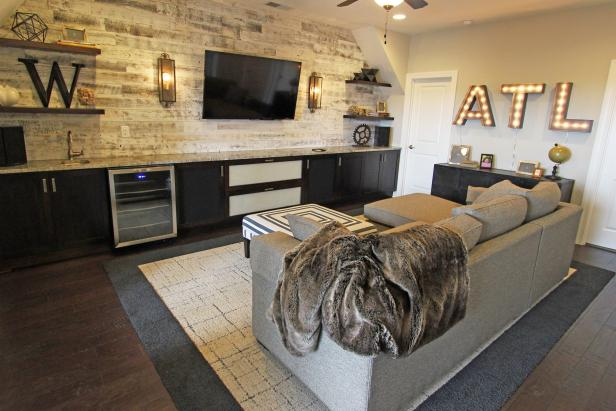Cozy, Rustic Media Room With Whitewashed Wood Feature Wall