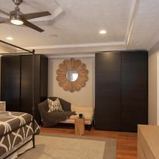 Chic Master Bedroom Lounge Area With Built-In Closets