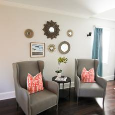 Upholstered Armchairs With Graphic Throw Pillows