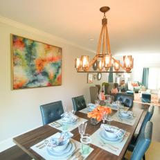 Architectural Chandelier Above Dining Table