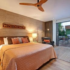 Contemporary Bedroom With Wood Accents & Patio Access