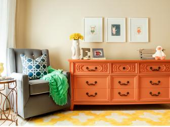Multicolored Contemporary Nursery With Orange Dresser