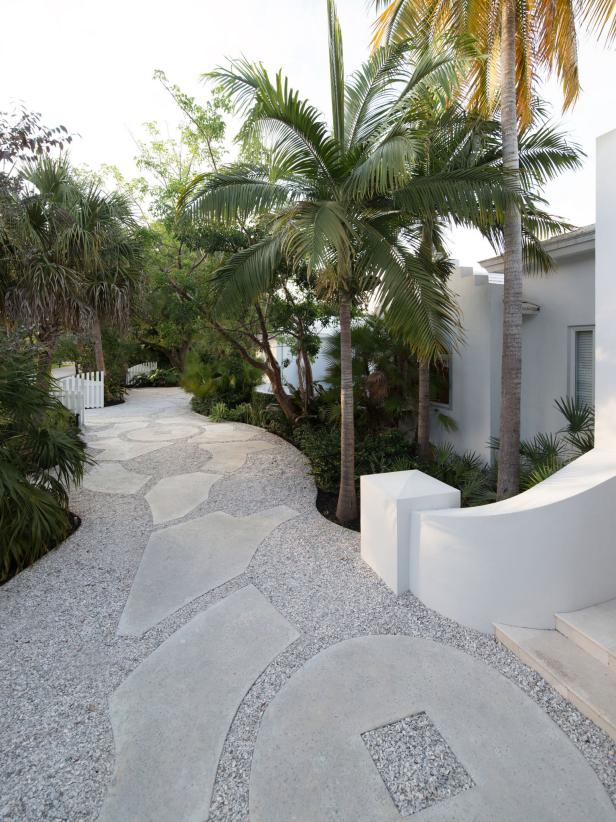 Large Paver Walkway Lined by Palm Trees
