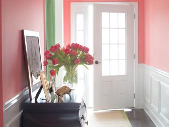 Coral Entryway With Chic Console Table and Tulips