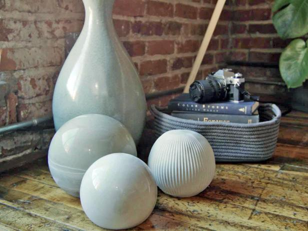 Make concrete spheres as indoor or outdoor decor with cement and old household containers.