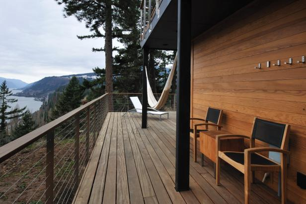 Cumaru Wood Deck With Cedar Siding, Cable Railing and Mixed Seating