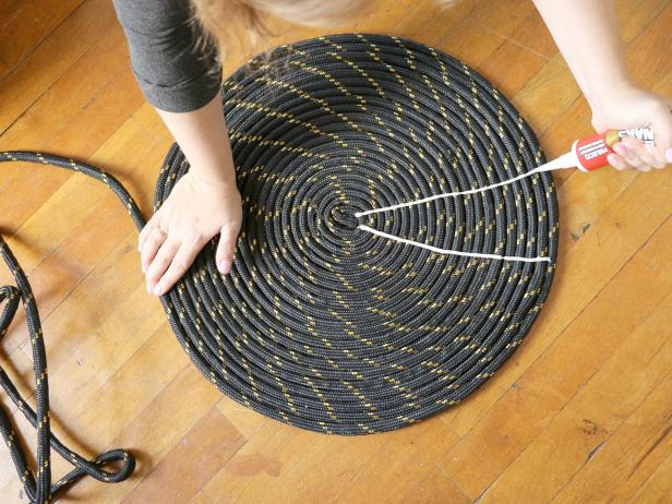 Use the liquid nails to create a starburst pattern on the rope coil.