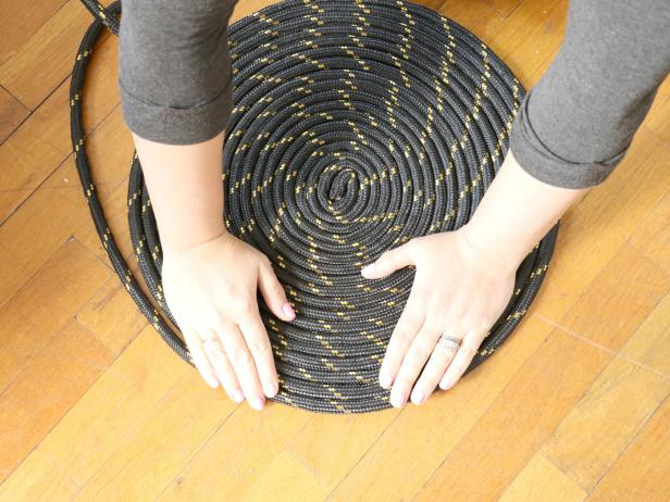 Coil the rope until the rug is approximately 24â across. Hold the coil down with your hands so it doesnât unravel.