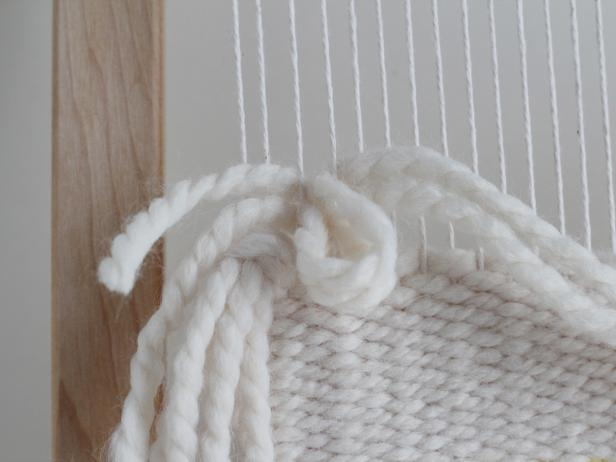Pull the ends of the yarn through the loop and pull down.