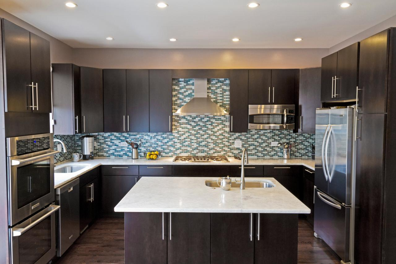 Photo page hgtv for Dark blue kitchen cabinets
