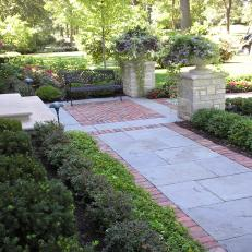 C.B.Conlin Landscapes: A Charming In-laid Pathway With Stone Columns and Planters